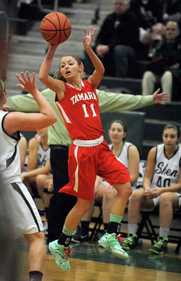 Tamarac's Jenna Erickson passes the ball off during their girl's high school basketball game against Shenendehowa on Saturday Feb. 1, 2014 in Clifton Park, N.Y. (Michael P. Farrell/Times Union) Photo: Michael P. Farrell / 10025584A