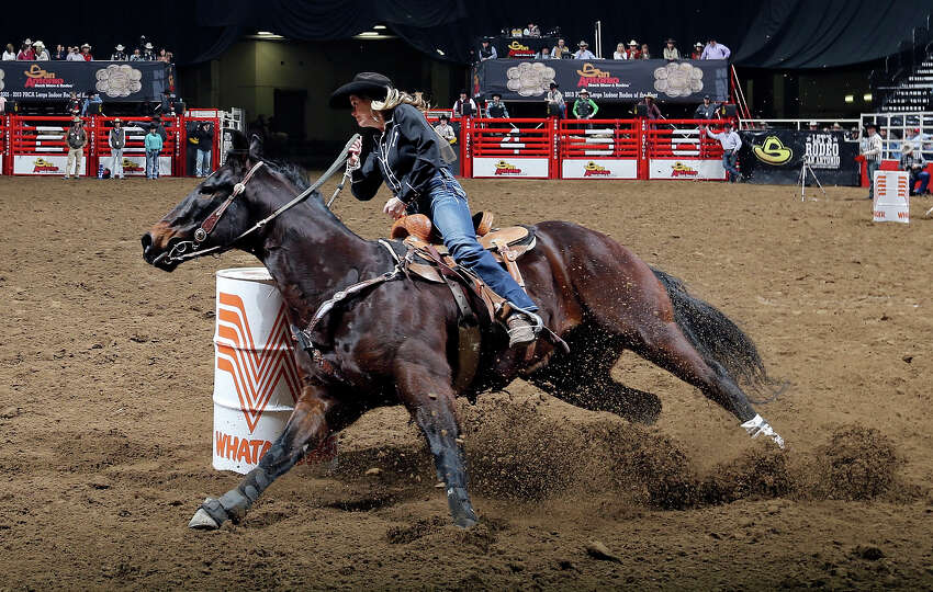 Shelly Anzick, of Livingston, MT, competes in the barrel racing event during the San Antonio Stock S
