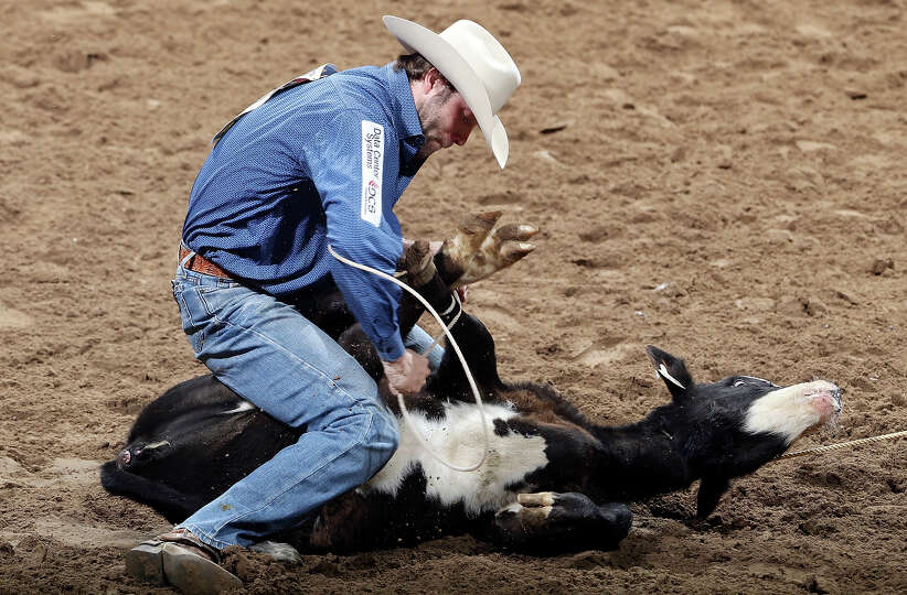 Adam Gray, of Seymour, TX, competes in the tie-down roping event during the San Antonio Stock Show &