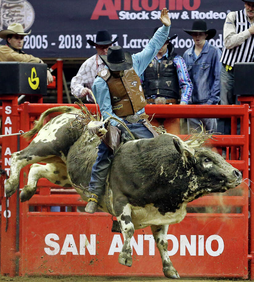 Caleb Sanderson, of Kissimmee, FL, competes in the bull riding event during the San Antonio Stock Show & Rodeo Monday Feb. 17, 2014 at the AT&T Center. Sanderson  scored an 86 on the ride. Photo: Edward A. Ornelas, San Antonio Express-News / © 2014 San Antonio Express-News