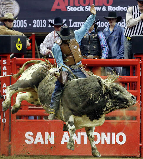 Caleb Sanderson, of Kissimmee, FL, competes in the bull riding event during the San Antonio Stock Sh