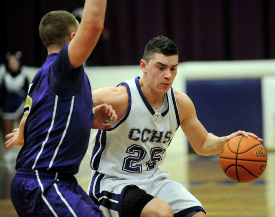 CCHS's Anthony Mack, right, controls the ball as CBA's Nick Marini defends during their basketball game on Friday, Feb. 7, 2014, at Catholic Central High in Troy, N.Y.  (Cindy Schultz / Times Union) Photo: Cindy Schultz / 00025677A