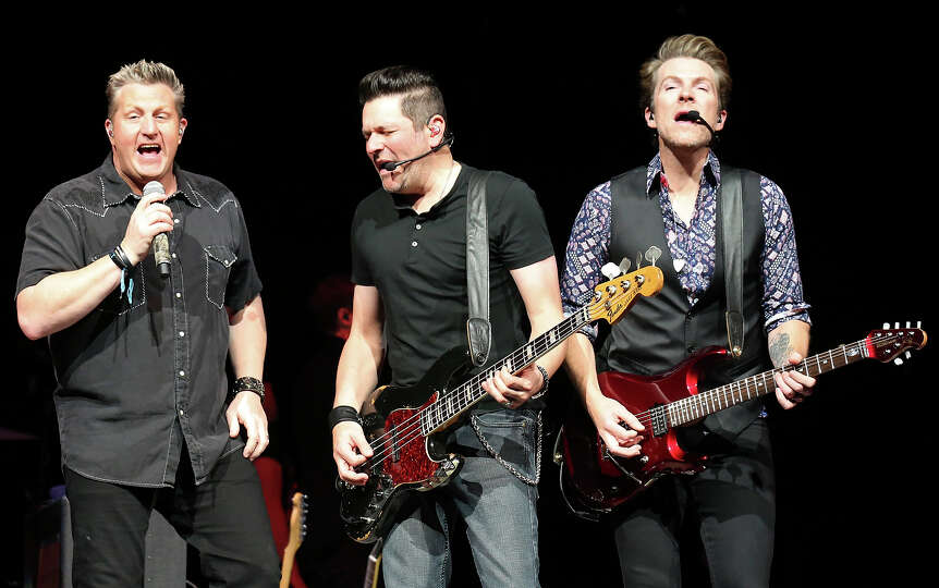 Rascal Flatts' Gary LeVox (from left), Jay DeMarcus, and Joe Don Rooney perform during the San Anton