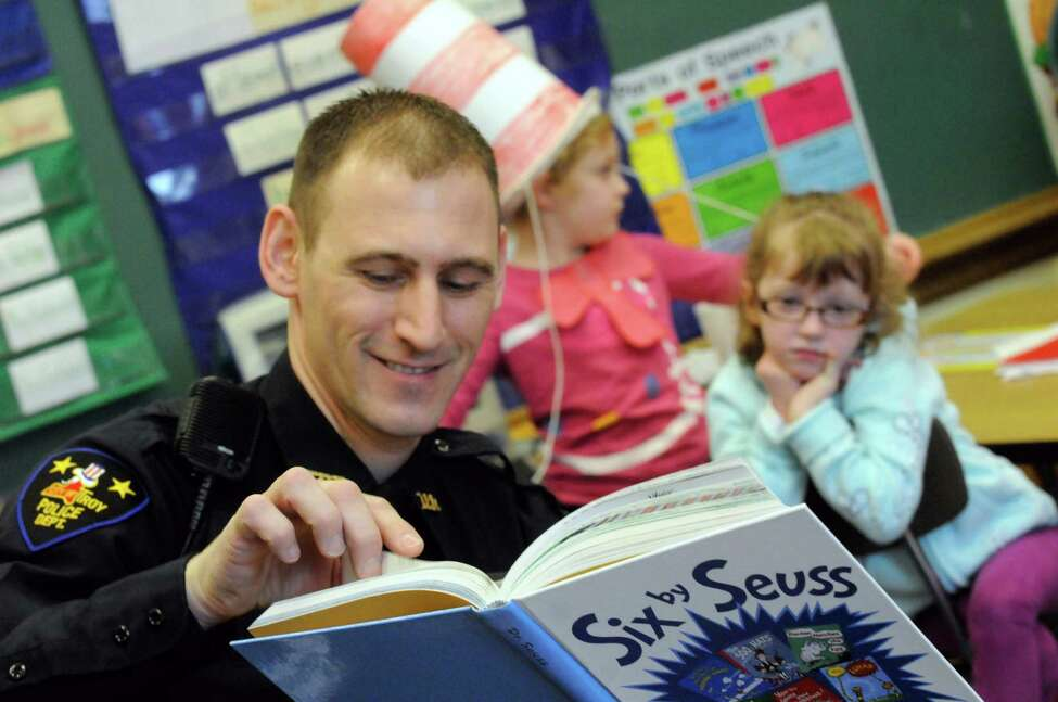 Troy Police officer Isaac Bertos reads Yertle the Turtle to School 16 first grade students in celebration of Dr. Seuss' birthday Friday March 2, 2012, at School 16 in Troy, N.Y. ( Michael P. Farrell/Times Union archive)