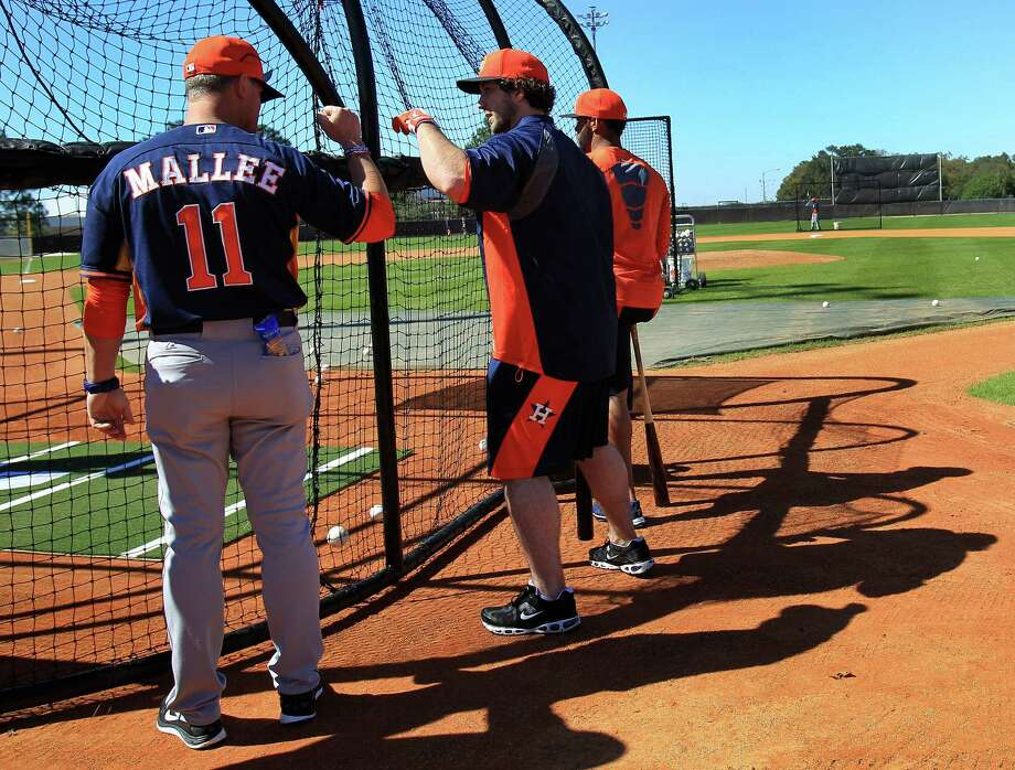 Hitting coach John Mallee wants fewer strikeouts from Brett Wallace, right, and the rest of the Astros after the club fanned a big league-record 1,535 times. Photo: Karen Warren, Staff / © 2013 Houston Chronicle