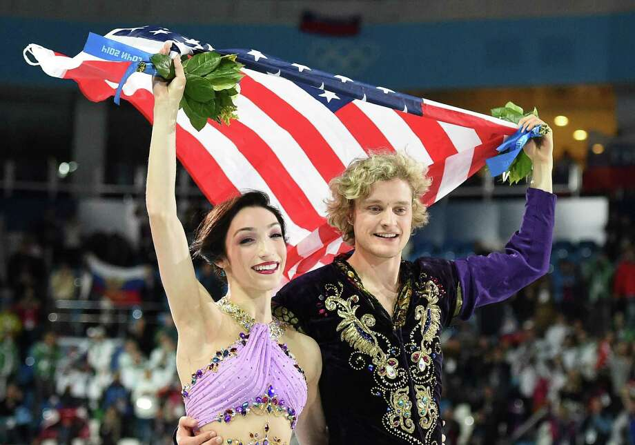 U.S. ice dancers Meryl Davis and Charlie White have been working together for 17 years, culminating in a gold medal. Photo: Damien Meyer / Getty Images / AFP