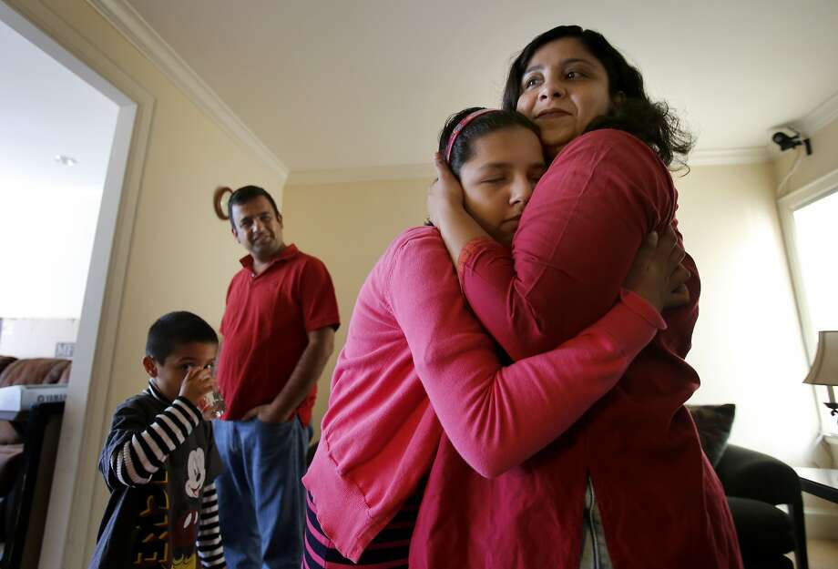 Epilepsy patient Shreeya Burman, 12, gets a hug before a family breakfast. Photo: Brant Ward, The Chronicle