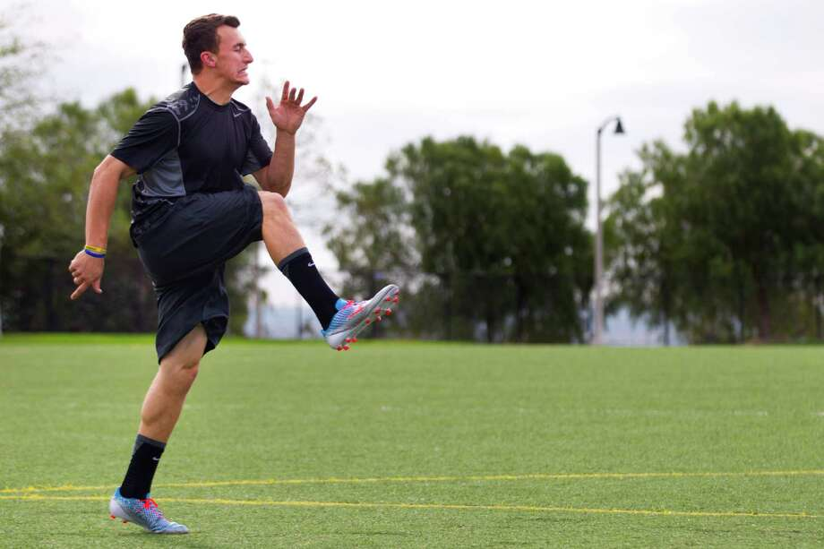 Former Texas A&M quarterback Johnny Manziel does high knee kicks while working out in preparation for the National Football League combine Monday, Feb. 10, 2014, in Carlsbad, Calif.  ( Brett Coomer / Houston Chronicle ) Photo: Brett Coomer, Staff / © 2014 Houston Chronicle