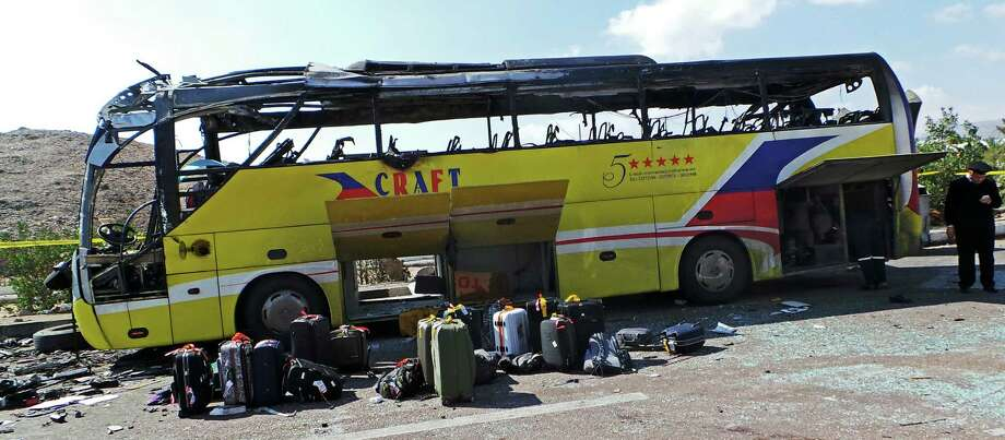 The bus driver and three tourists from South Korea were killed in the suicide bombing near Taba, Egypt, a Red Sea resort on the border with Israel. Photo: Uncredited / Associated Press / AP