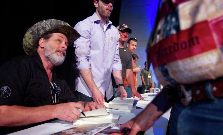 A vocal supporter of gun rights and the Second Amendment, Ted Nugent signs autographs at the National Rifle Association's May meeting in Houston. Photo: Johnny Hanson / Houston Chronicle / Houston Chronicle