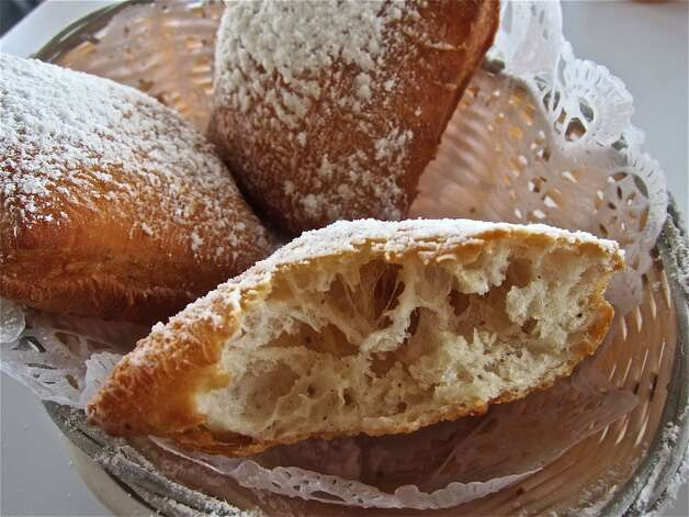 "Beignet (ben-YAY): A deep-fried doughnutlike pastry that's liberally covered with sugar. Audio: Click here to hear the term ""Beignet."" Photo: Alison Cook"