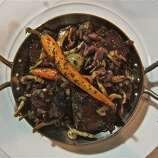"""Boeuf bourguignon (BOOF boor-gee-NYON): Hard to spell, much less pronounce, a classic French dish of beef braised in red wine and onions, and topped with sauteed mushrooms. Audio: Click here to hear the term """"Boeuf bourguignon."""""""