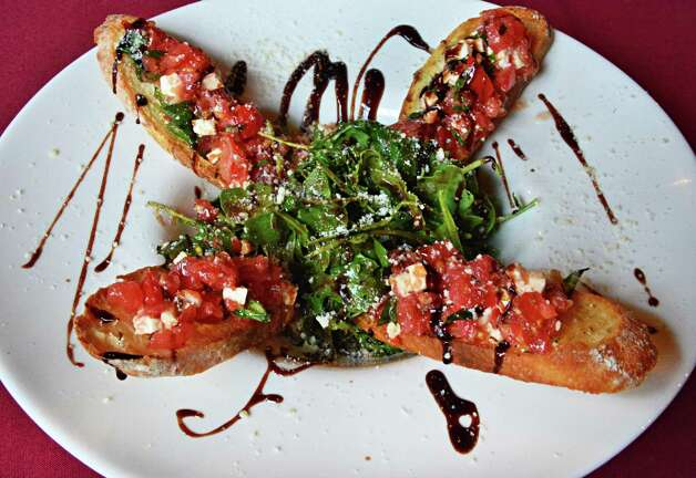 "Bruschetta (brew-SKETT-a): This garlic bread is sure to start a debate. In English, ""sch"" is pronounced ""sh."" In Italian, ""sch"" is pronounced as a ""k"" sound. No wonder people are confused. Audio: Click here to hear the term ""Bruschetta."" Photo: John Carl D'Annibale / 00023707A"