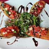 """Bruschetta (brew-SKETT-a): This garlic bread is sure to start a debate. In English, """"sch"""" is pronounced """"sh."""" In Italian, """"sch"""" is pronounced as a """"k"""" sound. No wonder people are confused. Audio: Click here to hear the term """"Bruschetta."""""""