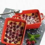 """Clafoutis (kla-foo-TEE): A French dessert beginning with a layer of fruit covered with a thin pancake-like batter, baked and garnished with powdered sugar. Audio: Click here to hear the term """"Clafoutis."""""""