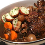 """Coq au vin (kohk-oh-VAHN): Very simply, it means chicken cooked in wine. Audio: Click here to hear the term """"Coq au vin."""""""
