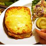 """Croque Monsieur (CROAK muhs-YOOR): A grilled ham and cheese sandwich, usually made with Swiss or Gruyère, that's dipped in beaten eggs before being grilled. Audio: Click here to hear the term """"Croque Monsieur."""""""