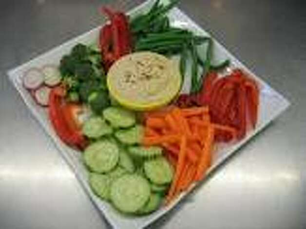 "Crudités (kroo-dee-TAY): An appetizer of cut, raw, seasonal vegetables. Audio: Click here to hear the term ""Crudités."""