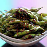 """Edamame (ed-dah-MAH-may): The Japanese word for immature soybeans. Audio: Click here to hear the term """"Edamame."""""""