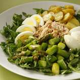 """Nicoise (nee-SWAAHZ): The French term literally means """"as prepared in Nice."""" Typically, it refers to a salad that is made with tomatoes, hard-cooked eggs, tuna, black olives and garlic. Audio: Click here to hear the term """"Nicoise."""""""