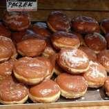 "Paczki (POONCH-key): A deep-fried jelly doughnut of Polish origin. Audio: Click here to hear the term ""Paczki."""