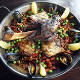 """Paella (pah-AY-yah): A Spanish dish of saffron rice with vegetables and meats, traditionally seafood. Audio: Click here to hear the term """"Paella."""""""