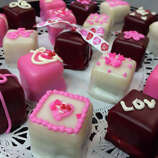 """Petit four (peh-TEE FOR): A bite-size iced cake. Audio: Click here to hear the term """"Petit four."""""""