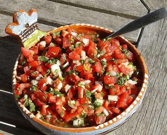 "Pico de gallo (PEE-koh deh GAH-yoh): A Spanish condiment of finely chopped tomatoes, onions, chiles, cilantro and citrus juice. Audio: Click here to hear the term ""Pico de gallo."" Photo: Robert McMahan"