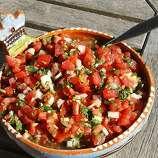 """Pico de gallo (PEE-koh deh GAH-yoh): A Spanish condiment of finely chopped tomatoes, onions, chiles, cilantro and citrus juice. Audio: Click here to hear the term """"Pico de gallo."""""""