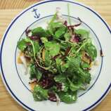 """Radicchio (ra-DEE-kyo): A red chicory variety used in salads. Audio: Click here to hear the term """"Radicchio."""""""