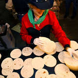 """Tortillas (tohr-TEE-yahs): If you live in San Antonio, you better know how to pronounce tortilla, the flat unleavened bread that is a staple of Mexico. Audio: Click here to hear the term """"Tortillas."""""""