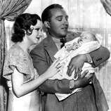 30th July 1933, US singer and film actor Bing Crosby pictured with his wife Dixie and also 3 week old son Gary Evan Crosby at their Hollywood Home  (Photo by Popperfoto/Getty Images)