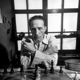 Artist retired to his chess board Marcel Dunchamp, playing by the hour at a table with a clock that keeps track of the time between moves.  (Photo by Eliot Elisofon//Time Life Pictures/Getty Images)