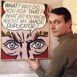 The American painter and representative of Pop Art Roy Lichtenstein shows one of his paintings, looking satisfied. 1964. (Photo by Mario De BiasiMondadori Portfolio by Getty Images)
