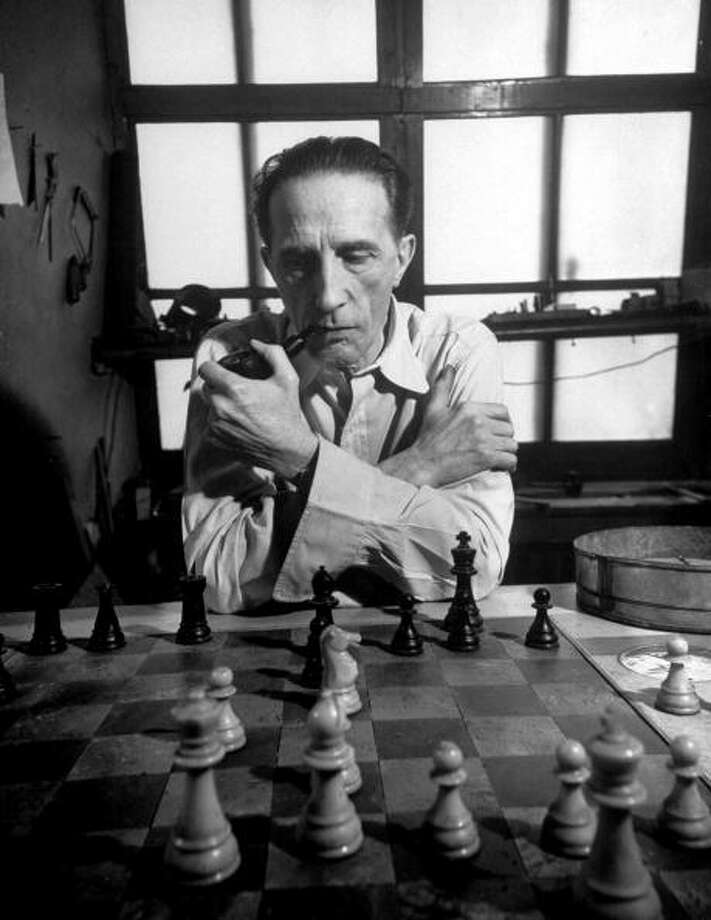 Artist retired to his chess board Marcel Dunchamp, playing by the hour at a table with a clock that keeps track of the time between moves.  (Photo by Eliot Elisofon//Time Life Pictures/Getty Images) Photo: Eliot Elisofon, Time & Life Pictures/Getty Image / Time Life Pictures