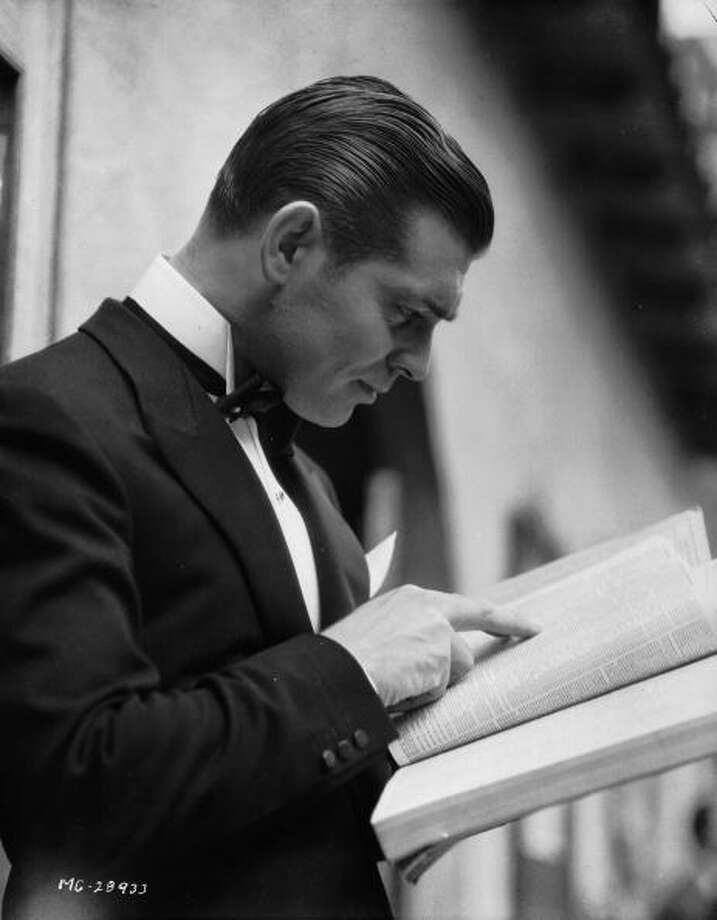 American actor Clark Gable (1901 - 1960) wearing a dinner jacket and looking through a directory.  (Photo via John Kobal Foundation/Getty Images) Photo: John Kobal Foundation, Getty Images / Moviepix