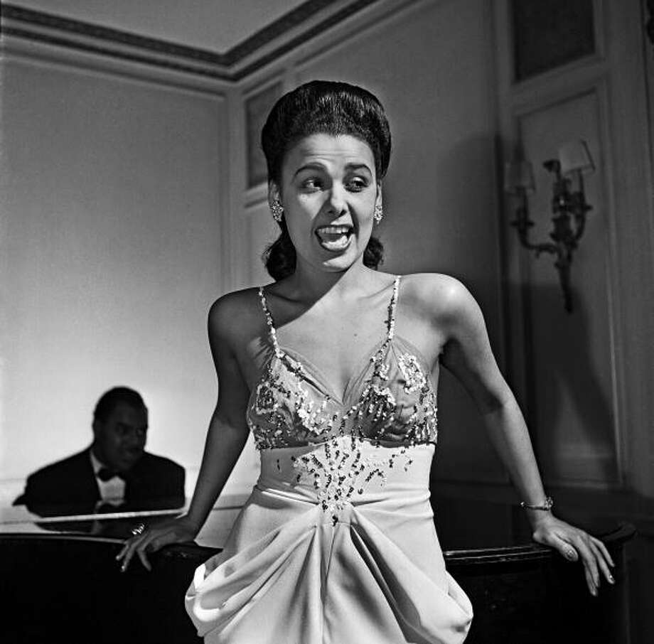 1942:  Singer Lena Horne performs at the Savoy-Plaza Hotel in late 1942 in New York, New York.  (Photo by Michael Ochs Archives/Getty Images) Photo: Michael Ochs Archives, Getty Images / Michael Ochs Archives