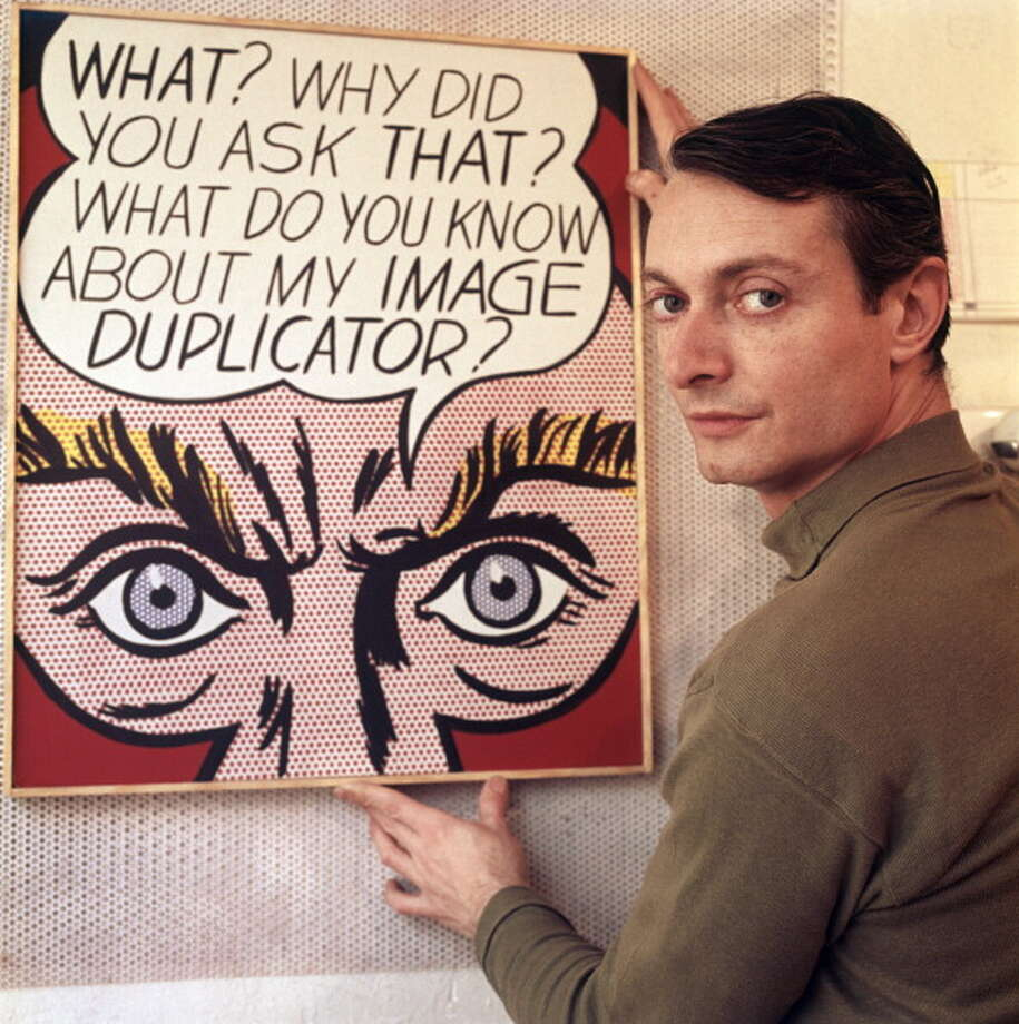 The American painter and representative of Pop Art Roy Lichtenstein shows one of his paintings, looking satisfied. 1964. (Photo by Mario De BiasiMondadori Portfolio by Getty Images) Photo: Mondadori, Mondadori Via Getty Images / Mario De Biasi per Mondadori Portfolio