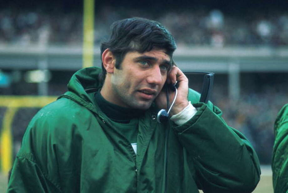 Quarterback Joe Namath #12 of the New York Jets talks on the headset on the sidelines to the coaches up in the booth during a game in the mid-1960's at Shea Stadium in Flushing, New York. (Photo by Kidwiler Collection/Diamond Images/Getty Images) Photo: Kidwiler Collection, Diamond Images/Getty Images / 1960 Diamond Images