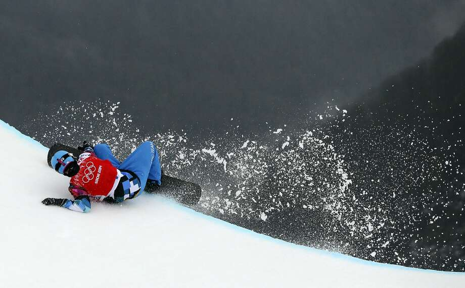 Austria's Allessandro Haemmerle crashes during a men's snowboard cross quarterfinal at the Rosa Khutor Extreme Park, at the 2014 Winter Olympics, Tuesday, Feb. 18, 2014, in Krasnaya Polyana, Russia. Photo: Sergei Grits, Associated Press