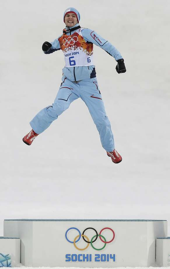 Norway's Joergen Graabak celebrates winning the gold during the flower ceremony of the Nordic combined individual Gundersen large hill competition at the 2014 Winter Olympics, Tuesday, Feb. 18, 2014, in Krasnaya Polyana, Russia. Photo: Matthias Schrader, Associated Press