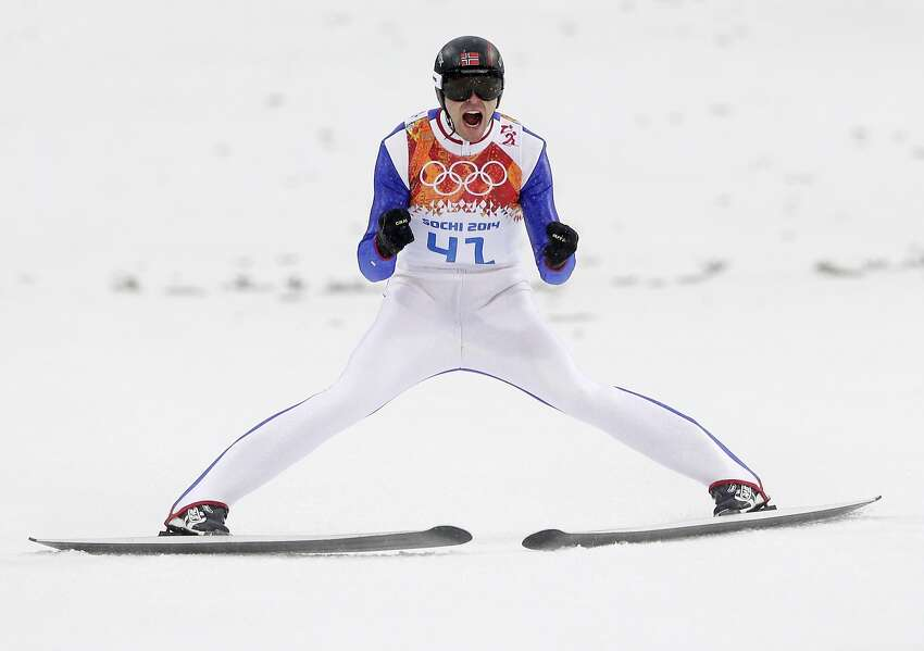 Norway's Magnus Hovdal Moan celebrates after his jump during the Nordic combined individual Gundersen large hill competition at the 2014 Winter Olympics, Tuesday, Feb. 18, 2014, in Krasnaya Polyana, Russia.