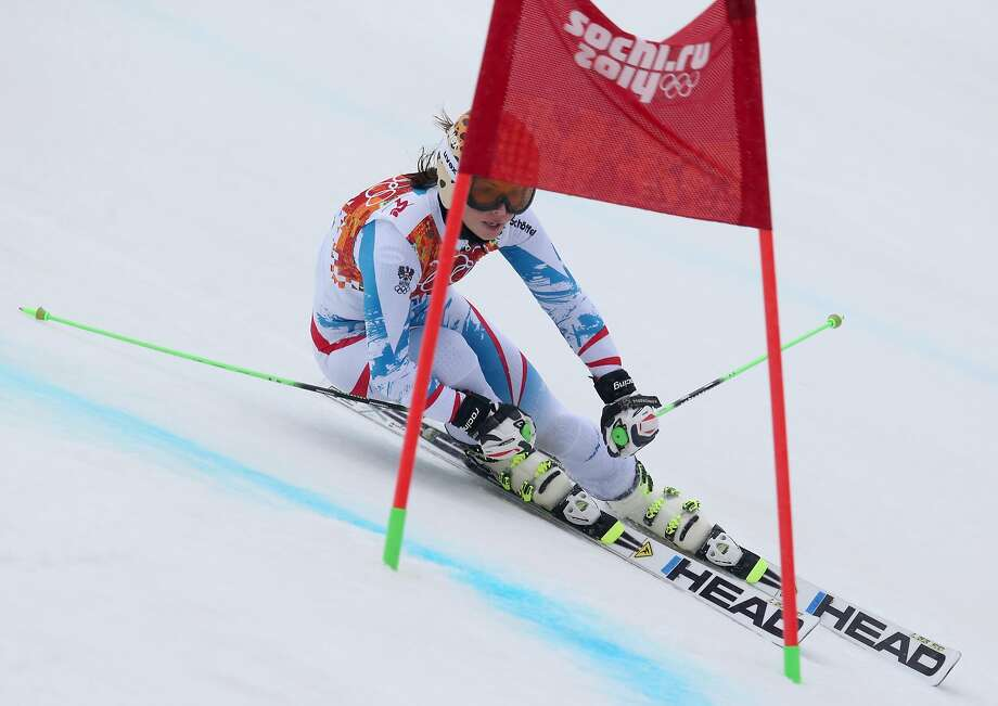 Austria's Anna Fenninger passes a gate in the second run of the women's giant slalom to win the silver medal at the Sochi 2014 Winter Olympics, Tuesday, Feb. 18, 2014, in Krasnaya Polyana, Russia. Photo: Alessandro Trovati, Associated Press