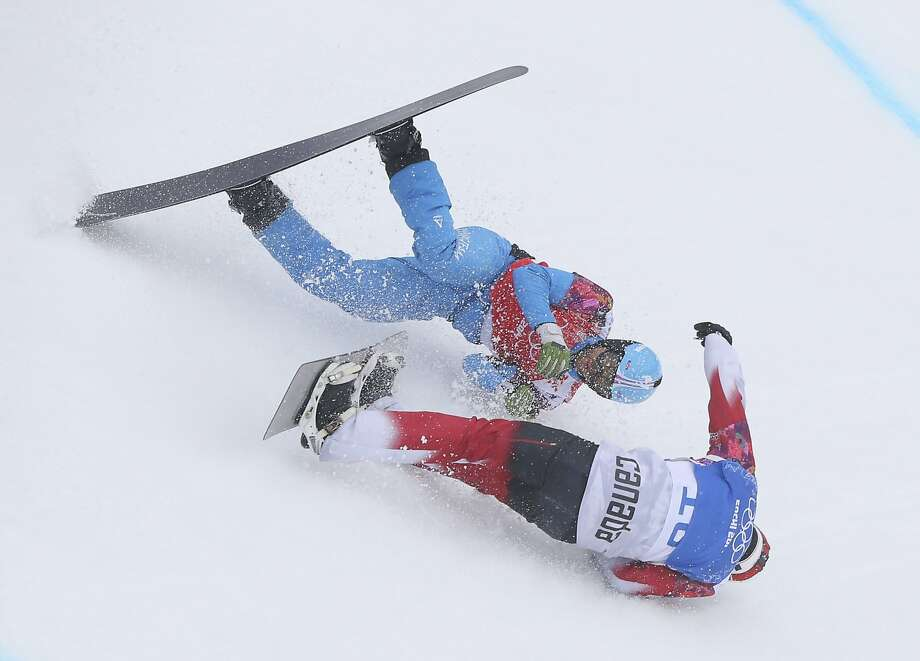 Austria's Markus Schairer, top, and Canada's Robert Fagan crash during a men's snowboard cross heat at the Rosa Khutor Extreme Park, at the 2014 Winter Olympics, Tuesday, Feb. 18, 2014, in Krasnaya Polyana, Russia. Photo: Sergei Grits, Associated Press