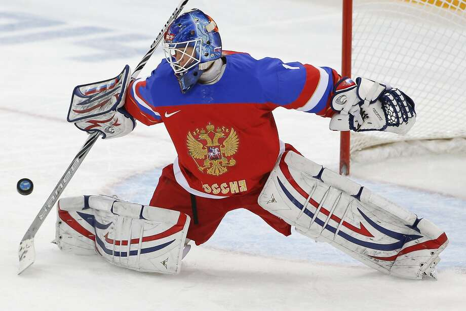 Goalkeeper Anna Prugova of Russia blocks a shot on goal during the first period of the 2014 Winter Olympics women's ice hockey game against Finland at Shayba Arena, Tuesday, Feb. 18, 2014, in Sochi, Russia.  Photo: Petr David Josek, Associated Press