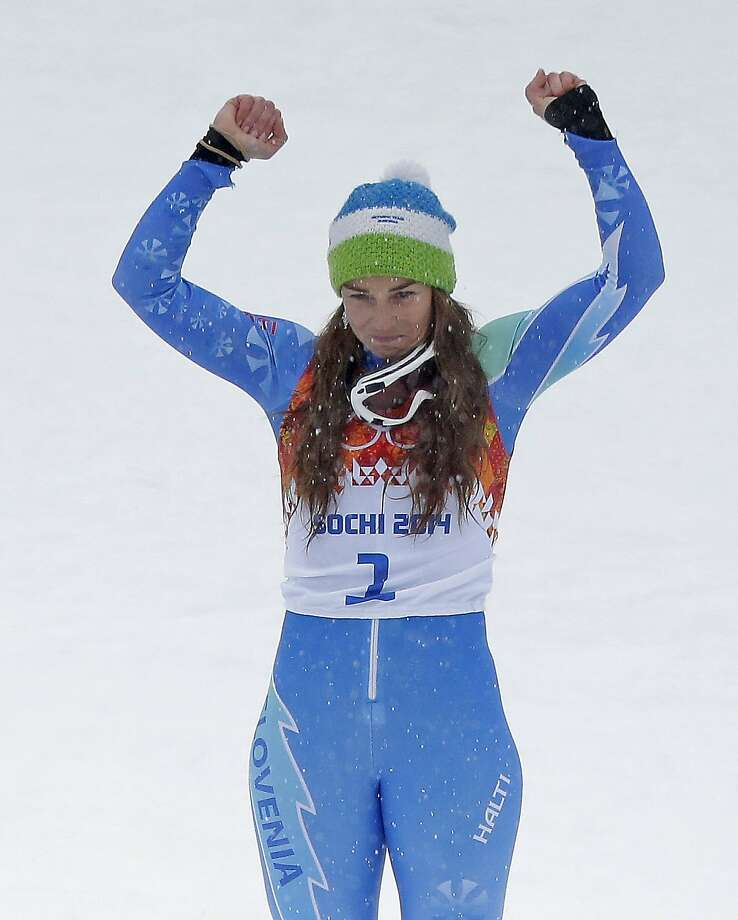 Women's giant slalom gold medalist Slovenia's Tina Maze celebrates during the flower ceremony at the Sochi 2014 Winter Olympics, Tuesday, Feb. 18, 2014, in Krasnaya Polyana, Russia.  Photo: Charlie Riedel, Associated Press