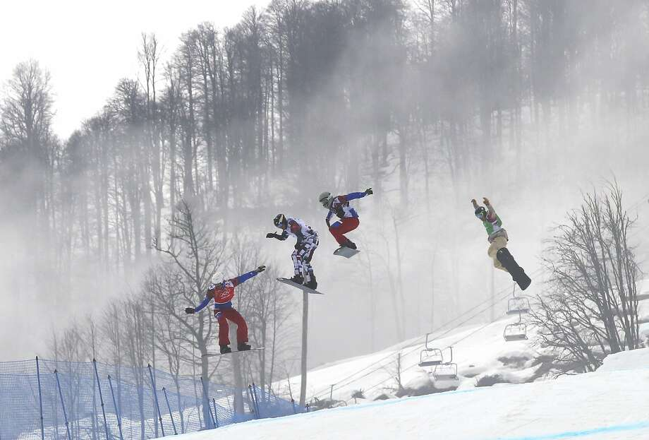 Gold medalist Pierre Vaultier of France, left, leads, from second left to right, silver medalist Nikolai Olyunin of Russia, Paul­Henri de le Rue of France, and bronze medalist Alex Deibold of the United States, in the men's snowboard cross final at the Rosa Khutor Extreme Park, at the 2014 Winter Olympics, Tuesday, Feb. 18, 2014, in Krasnaya Polyana, Russia. Photo: Sergei Grits, Associated Press