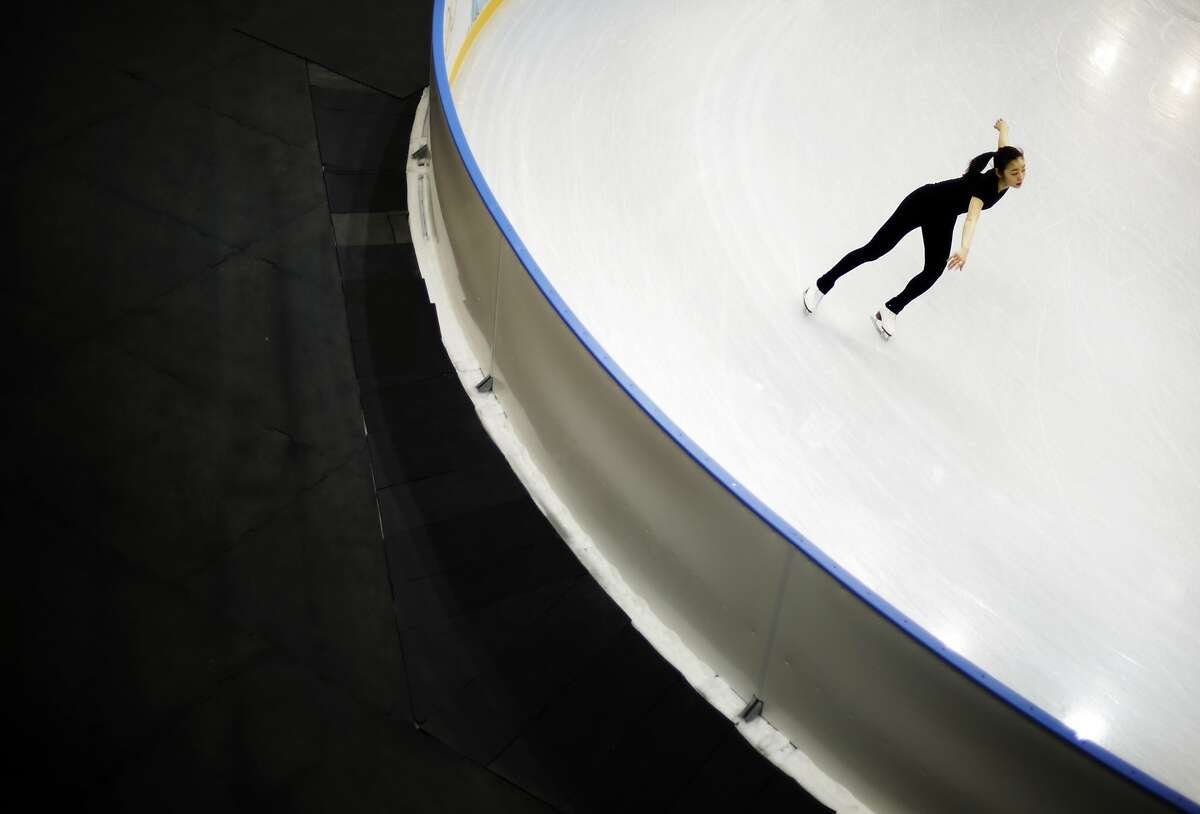 Yuna Kim of South Korea performs during the practice session at Iceberg Skating Palace at the 2014 Winter Olympics, Tuesday, Feb. 18, 2014, in Sochi, Russia.