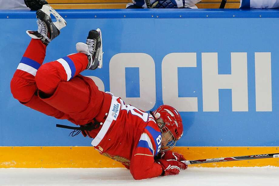 Yekaterina Smolina of Russia falls on the ice after colliding with Emma Terho of Finland during the second period of the 2014 Winter Olympics women's ice hockey game at Shayba Arena, Tuesday, Feb. 18, 2014, in Sochi, Russia. Photo: Petr David Josek, Associated Press