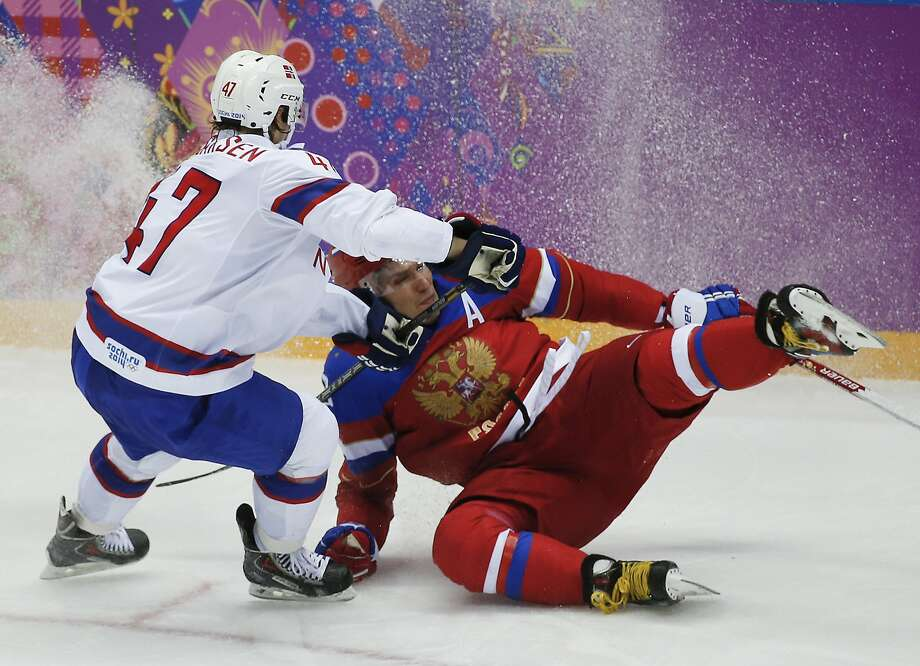 Norway defenseman Alexander Bonsaksen collides with Russia forward Alexander Ovechkin in the third period of a men's ice hockey game at the 2014 Winter Olympics, Tuesday, Feb. 18, 2014, in Sochi, Russia. Photo: Julio Cortez, Associated Press